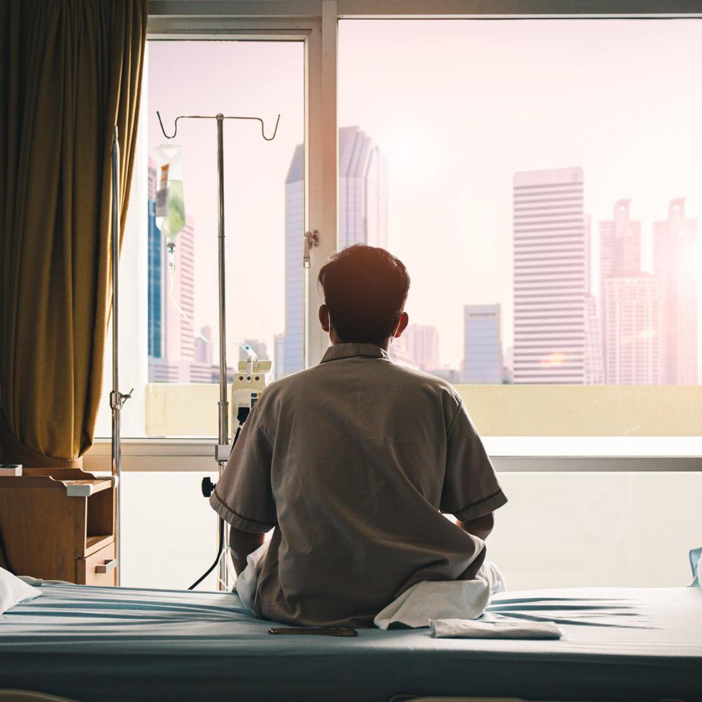 Doctor-sat-on-hospital-bed